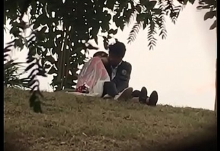 Indian lover kissing in park fixing 2